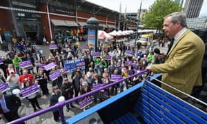 Nigel Farage addresses supporters from his tour bus in Birmingham.