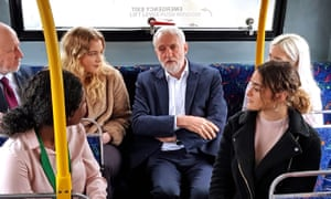 Labour leader Jeremy Corbyn and transport secretary Andy McDonald speak with young people on a bus in Derby.