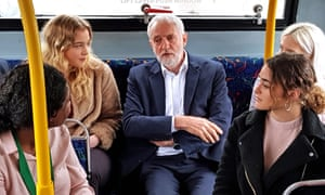 Jeremy Corbyn travelling on a bus with young people