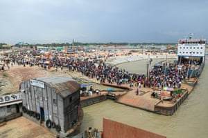Thousands of people return to Dhaka by ferry in Bangladesh.