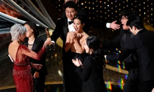 Kwak Sin-ae and Bong Joon-ho accept the Oscar for best picture for Parasite.