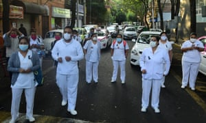 Groups of health workers protest to denounce the death of several specialists for not having the basic protection equipment in Mexico City on Tuesday.