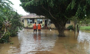 Red Cross workers check a flooded house in Apia, Samoa, after Tropical Cyclone Gita