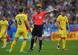 Romania's Vlad Chiriches receives the first yellow of the tournament.
