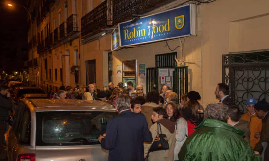 Homeless people and supporters of the charity behind the Robin Hood restaurant in Madrid gather for its launch on Tuesday.