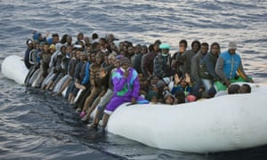 Migrants and refugees aboard a rubber boat in the Mediterranean