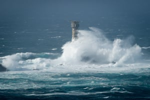 Waves break on Longships lighthouse off the coast of Land's End, Cornwall