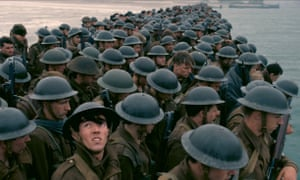 'Storm-blue elegy': massed soldiers await evacuation in Christopher Nolan's stirring battle study, Dunkirk. Warner Bros