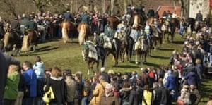 Pilgrims ride during the procession