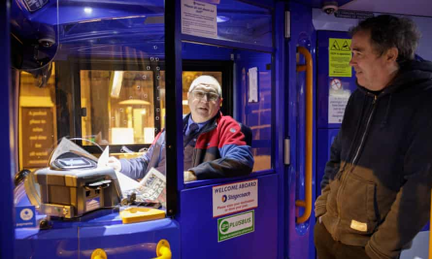 Bus driver Graham Camburn and his passenger Jamie McTavish wait for departure.