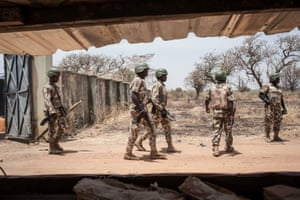 Soldiers from the Nigerian army patrol at the school in Chibok from which Boko Haram kidnapped 276 girls in April 2014.