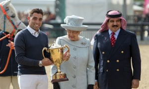 The Queen, centre, joins the King of Bahrain, right, at last year's Royal Windsor Horse Show