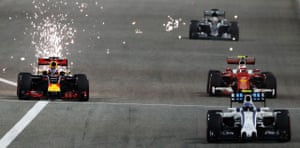 Daniel Ricciardo sparking down the start finish straight as he battles with Kimi Raikkonen.