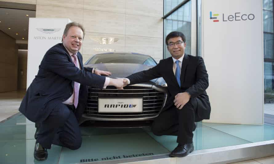 Andy Palmer and Lei Ding with the Aston Martin RapidE concept car