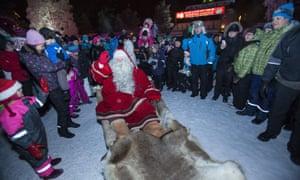 Crowds gather round Santa Claus in Rovaniemi.