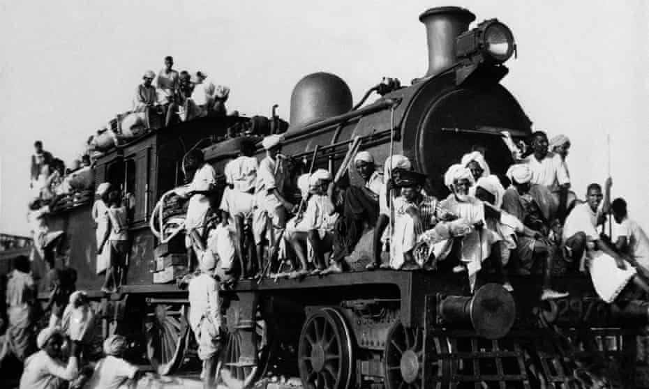 Muslim refugees cram aboard a train during the partition conflict in 1947 ... the railways were first conceived by the East India Company for its own benefit. Photograph: AP
