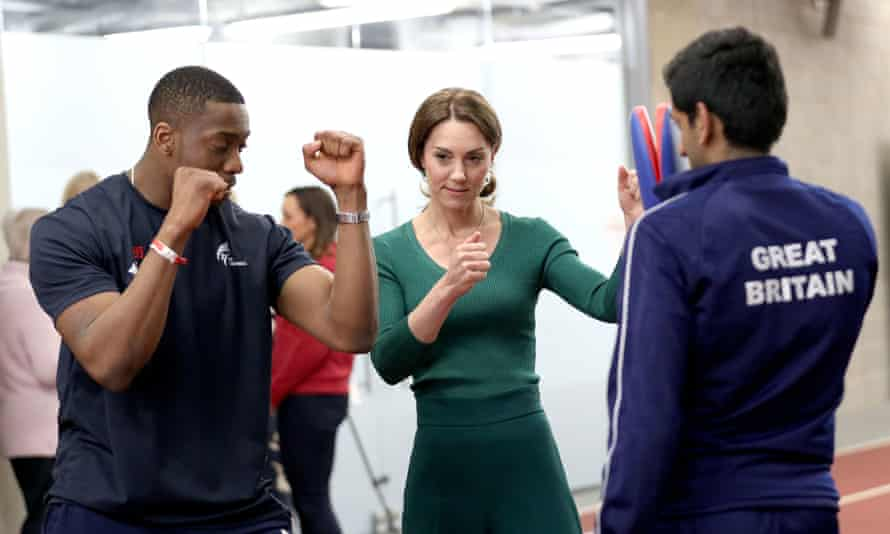 Lutalo Muhammad (left) demonstrating taekwondo to the Duchess of Cambridge during a SportsAid event at the London Stadium in Stratford.