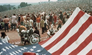 A giant Stars and Stripes makes an improvised tent at the Woodtsock festival in August 1969.