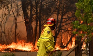 A firefighter works to contain a fire near Bilpin, NSW