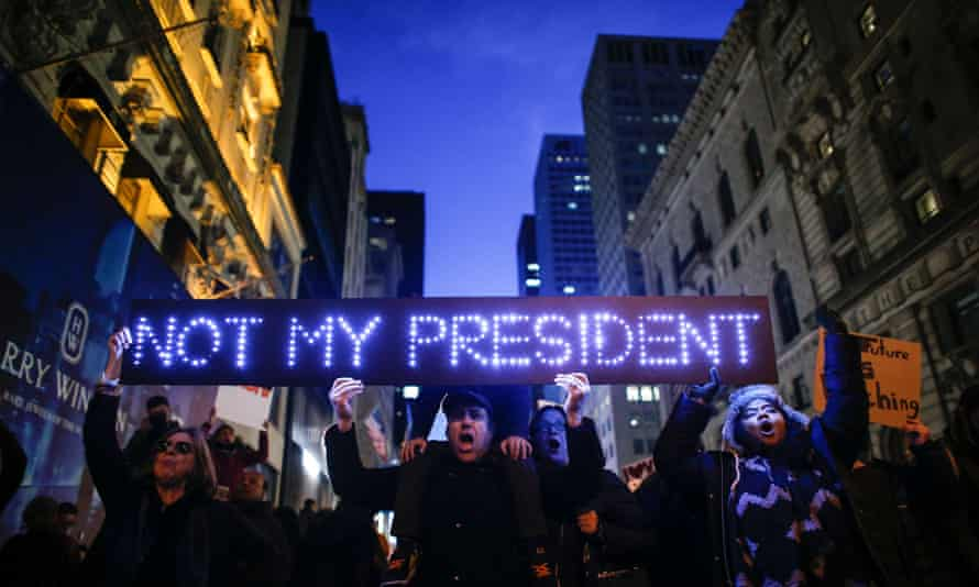 Demonstrators protest against Donald Trump in front of Trump Tower on 12 November 2016 in New York.