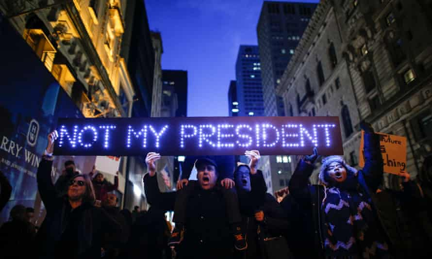 AFP PICTURES OF THE YEAR 2016 Demonstrators protest against US President-elect Donald Trump in front of Trump Tower on November 12, 2016 in New York. Americans spilled into the streets Saturday for a new day of protests against Donald Trump, even as the president-elect appeared to back away from the fiery rhetoric that propelled him to the White House. / AFP PHOTO / KENA BETANCURKENA BETANCUR/AFP/Getty Images