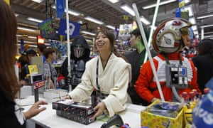Fans dressed as Star Wars characters at a toy store in Hong Kong.