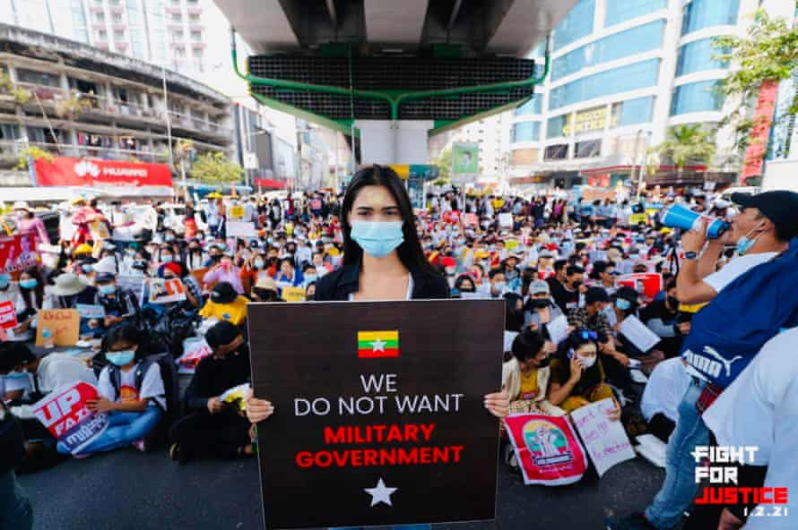 The Myanmar beauty queen Thuzar Wint Lwin stands before a crowd in Yangon at a protest against the military regime in February.