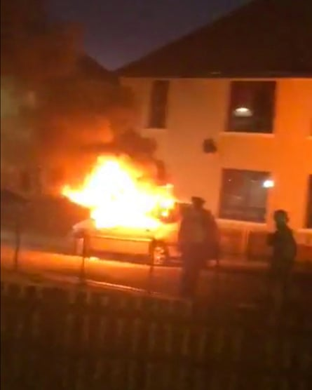 A screengrab showing a car set on fire by an angry mob in Armadale, West Lothian