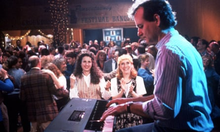 Bill Murray playing the keyboard and Andie MacDowell in Groundhog Day.
