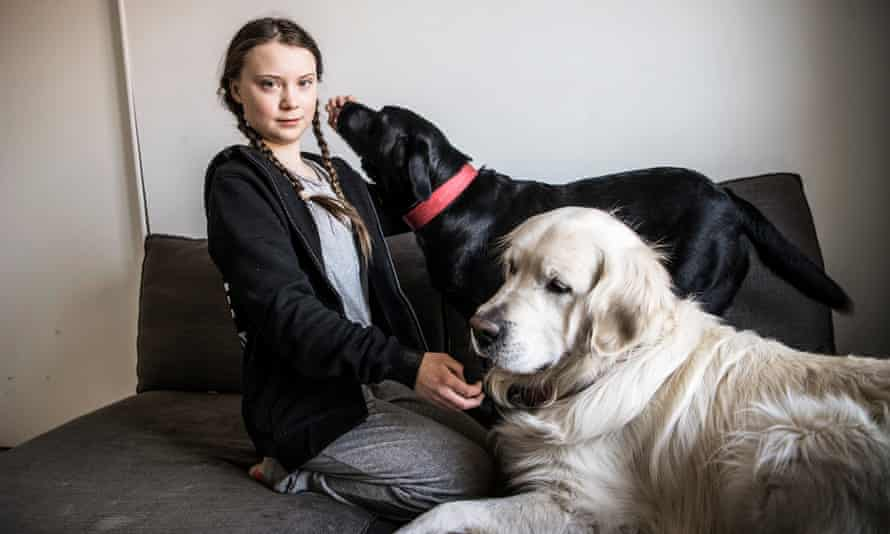Greta Thunberg with her dogs at home in Stockholm.