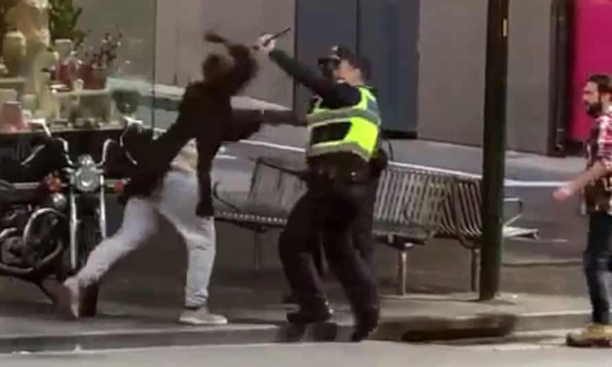 Hassan Khalif Shire Ali attacking police officers