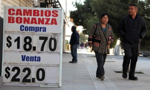 Sign shows devaluation of Mexican peso
