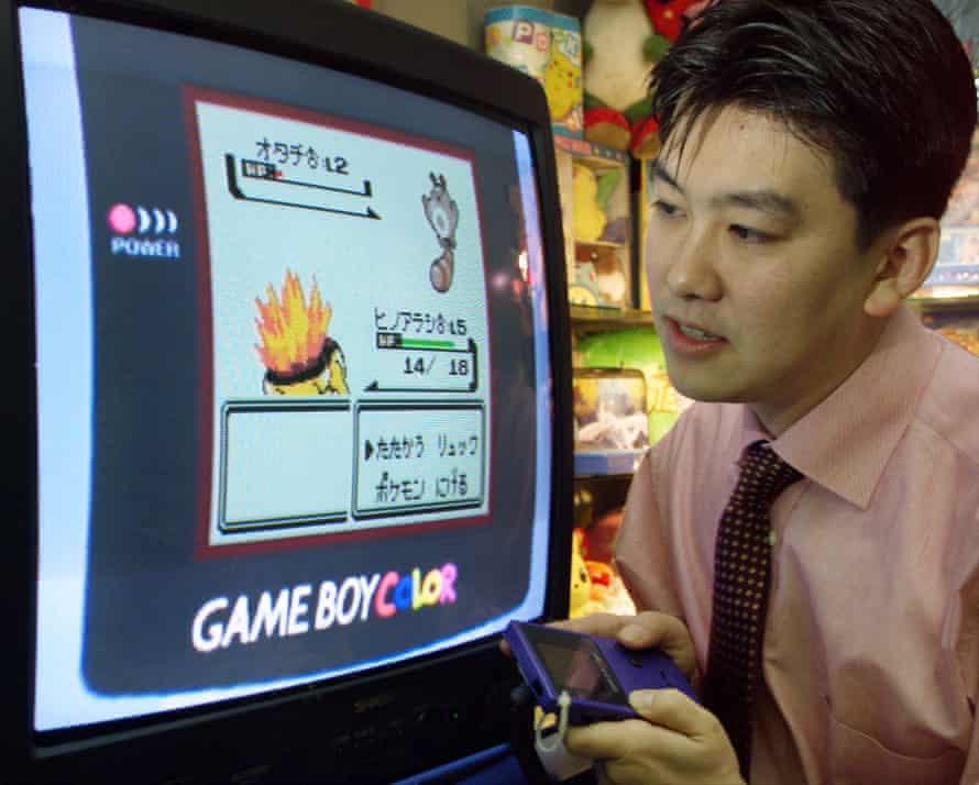A Nintendo sales representative demonstrates Pokemon in 1999.
