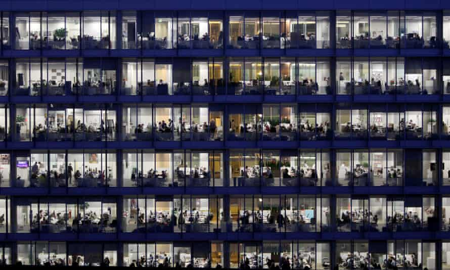 workers pictured late at night in an office block