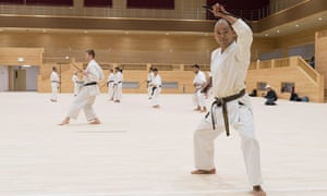 A karate practitioner practises in the dojo at Okinawa's new kaikan