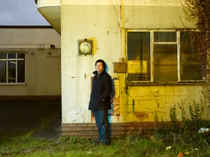 Cornershop frontman Tjinder Singh photographed at an old petrol station near his former home in Wednesfield in the West Midlands