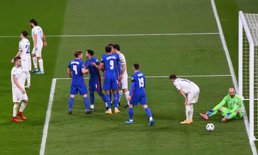 England celebrate their fourth goal against San Marino.