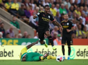 Manchester City's Raheem Sterling avoids a challenge as he surges forward.