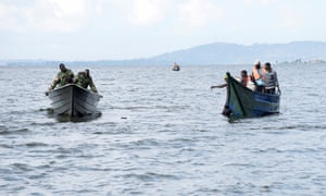Rescuers search for bodies after a cruise boat capsized in Lake Victoria off the Ugandan coast.