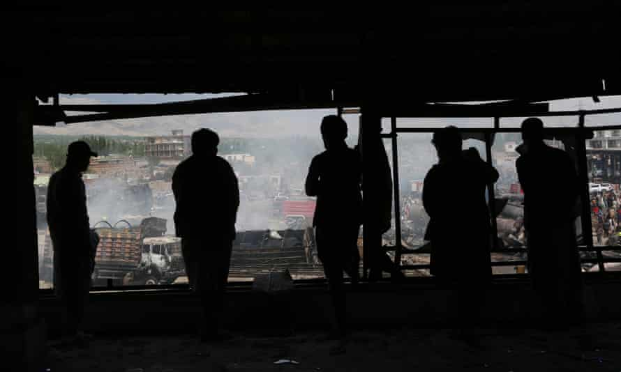 People view an explosion site in Kabul earlier in the year