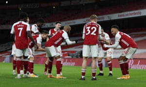 Arsenal celebrate in the socially distanced style.