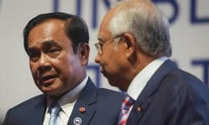 Prayuth Chan-ocha (left) speaking to the Malaysian prime minister, Najib Razak, this week.