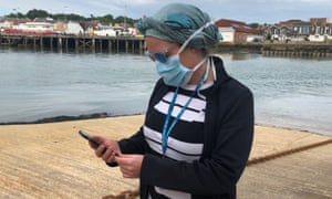 NHS worker Anni Adams looking at the contact tracing app which has been trialled on the Isle of Wight.