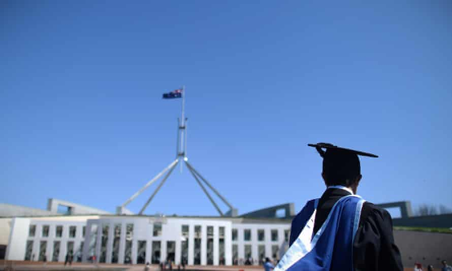 A university graduate is seen outside Parliament House in Canberra. Four university-level Asian language subjects have been cut at Australian universities in 2021 as institutions cope with the ongoing economic impact of the pandemic.