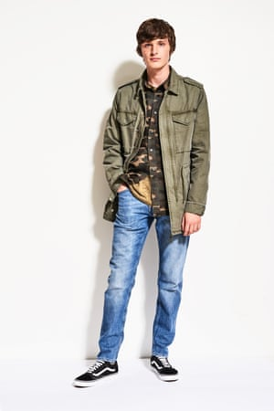 Model wears an army jacket and jeans