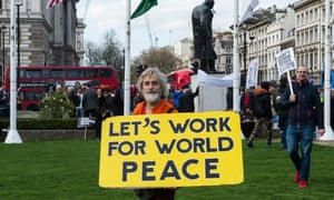 Anti-war demonstrators protest against military interventions in Syria, 14 April, London.