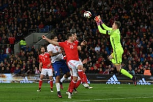 Wayne Hennessey claims the ball from Tadic's free-kick.