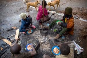 Street children eat lunch in the slum.