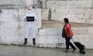 """A woman in Lisbon, Portugal, after the Portuguese prime minister António Costa announced on Monday the """"state of calamity"""" will be maintained in Greater Lisbon with tougher rules to contain Covid-19."""