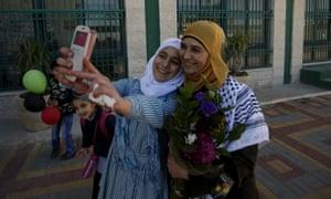A Palestinian student takes a selfie with teacher Hanan al-Hroub.